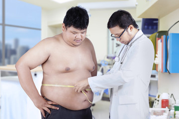 Doctor measuring a patient obesity
