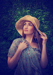 Beautiful young woman in wide hat