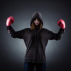 Female boxer in red gloves.