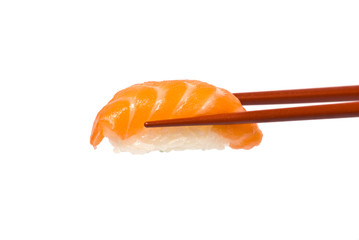 Sushi with Salmon is held by Chopsticks isolated on white