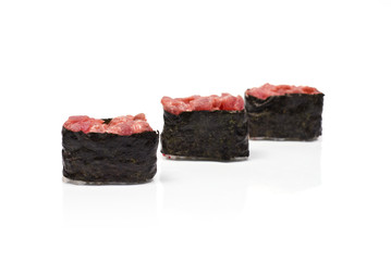 Three Gunkan Maki with Tuna isolated on white