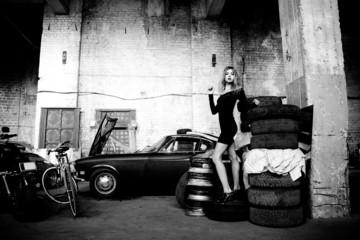 fashionable woman in retro garage