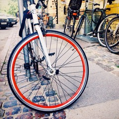Bicycle wheel with red rim.