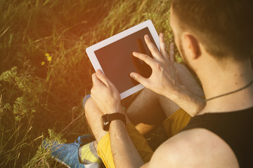 Man working outdoors with tablet pad. Retro vintage instagram fi
