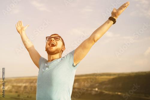 Leinwanddruck Bild Handsome man outdoors portrait with a retro vintage instagram fi