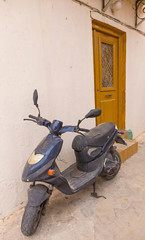 scooter and the door