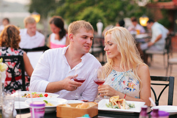 Beautiful couple eating at restaurant outside