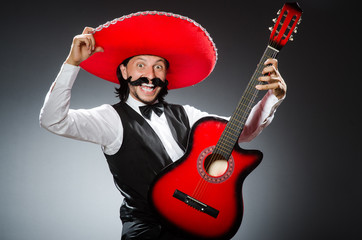 mexican man with guitar isolated on white