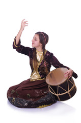Young azeri woman playing traditional drum nagara