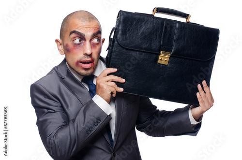 Badly beaten businessman isolated on white
