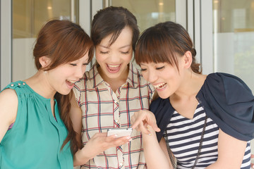 women looking at something on a cellphone