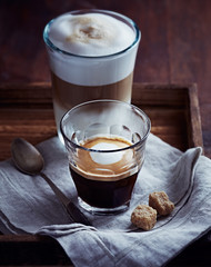 Glass of Espresso Macchiato and Latte Macchiato on a Tray