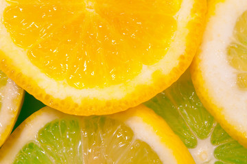 Abstract background of citrus slices. Close-up.