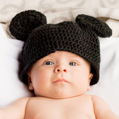 Two month baby with a black wool hat