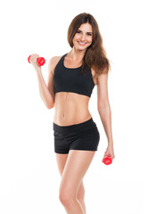 Beautiful slim woman with dumbbells on white