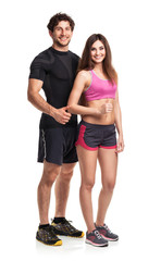 Athletic man and woman with thumb up on the white
