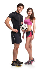 Athletic man and woman with ball on the white background