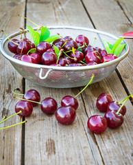 Fresh cherry on wooden table