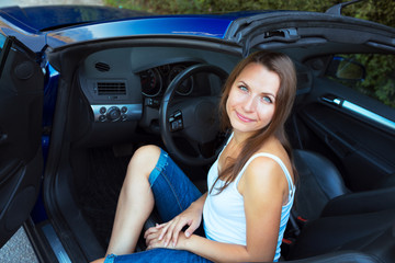 Caucasian woman in a cabriolet
