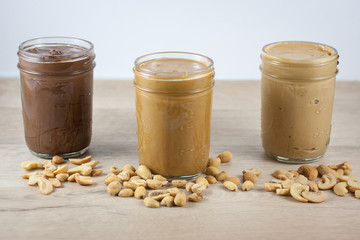 Homemade nut butters in canning jars.