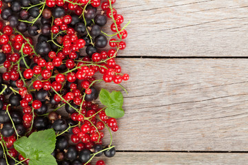 Fresh ripe currant berries on wooden table