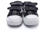 Black sneakers for a baby on white background