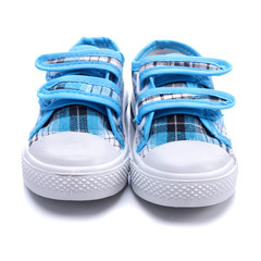 Blue sneakers for a baby on white background