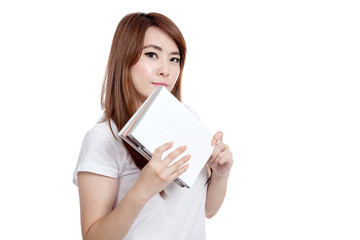 Asian girl hold a book look at camera