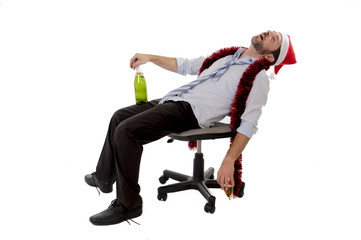 drunk businessman at office sleeping drunk in santa hat