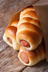 rolls with sausage closeup wrapped in paper vertical