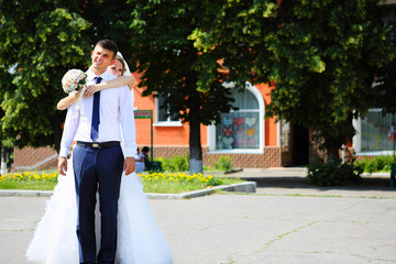 Bride and groom on a city street