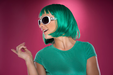 Beautiful trendy lady with green hair