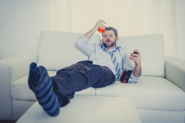 drunk Businessman drinking whiskey on couch