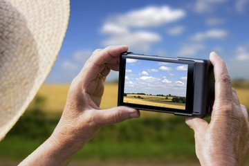 woman taking picture of typical english landscape