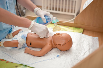 newborn resuscitation on a mannequin