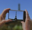 roleta: woman taking picture of eiffel tower on holiday