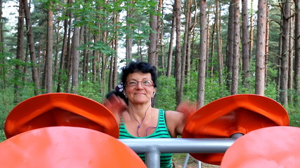 Smiling woman training at outdoor gym in forest