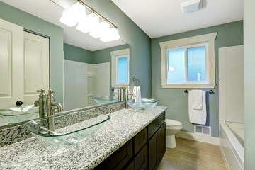 Modern bathroom interior in soft aqua color