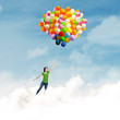 Woman flying with balloons