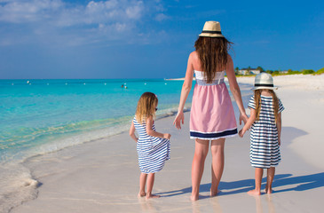 Back view of mother and little daughters enjoy summer vacation