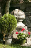 Corner of old garden with stonework, plants and flowers poster