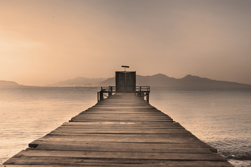 Wooden Dock on Calm Lake