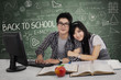 Young couple in class