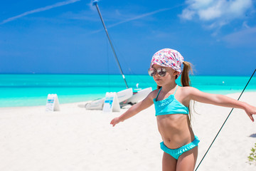 Adorable little girl have fun during caribbean vacation