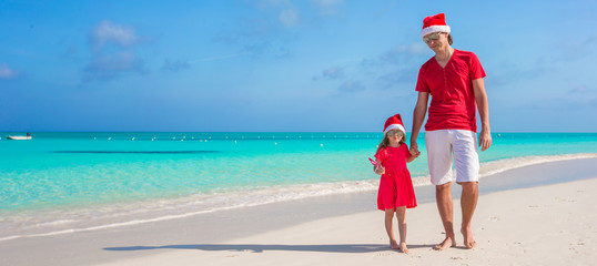 Family in Christmas Hat at tropical beach