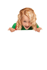 little blonde girl over blank billboard