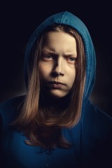Angry teen girl in hood