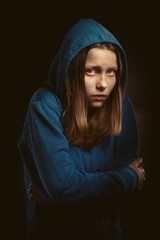 Afraid teen girl in hood