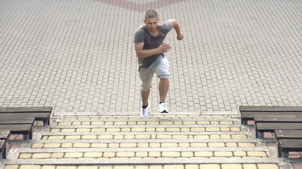 Man running up the stairs, super slow motion, 240fps