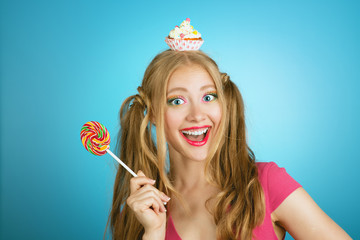 pretty candy girl with lollipop and cupcake cheerful